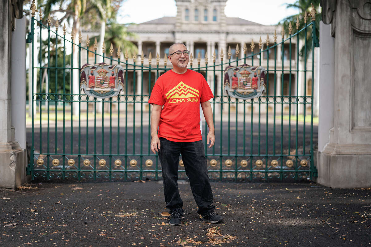 Kyle Kajihiro stands in front of royal residence Iolani Palace in Honolulu, Hawaii, Jan. 13, 2021.