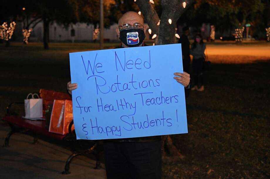 Eduardo Villa Jr. holds up a sign demanding for a rotation schedule during a TSTA protest, moments before hearing the news of the board approving of rotation schedules for LISD employees. Photo: Christian Alejandro Ocampo /Laredo Morning Times / Laredo Morning Times