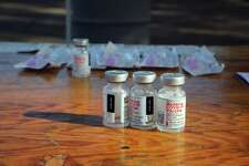 Vials containing the Moderna COVID-19 vaccine on a table at a vaccination site in Santa Rosa, Calif., on Wednesday, Jan. 13, 2021, amid the coronavirus pandemic. (Jim Wilson/The New York Times)
