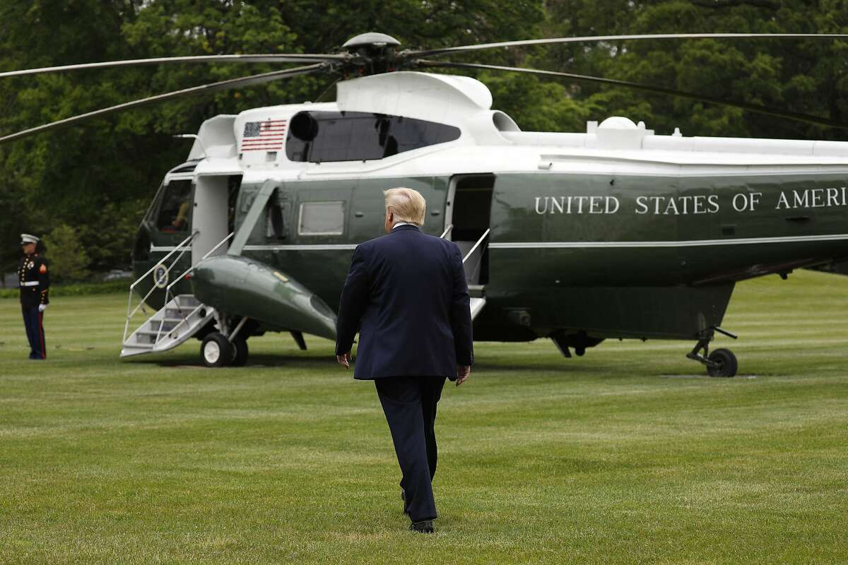 President Donald Trump walks to board Marine One helicopter on the South Lawn of the White House in Washington before his departure to Detroit on May 21.