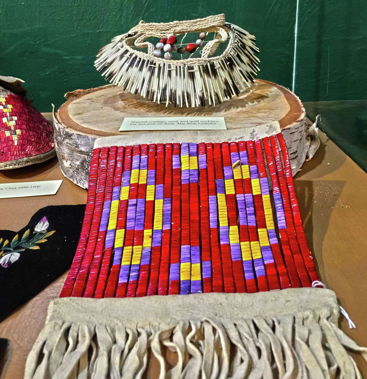 Examples of exhibits, including a bag made with porcupine quills, on display at the Institute of American Indian Studies.