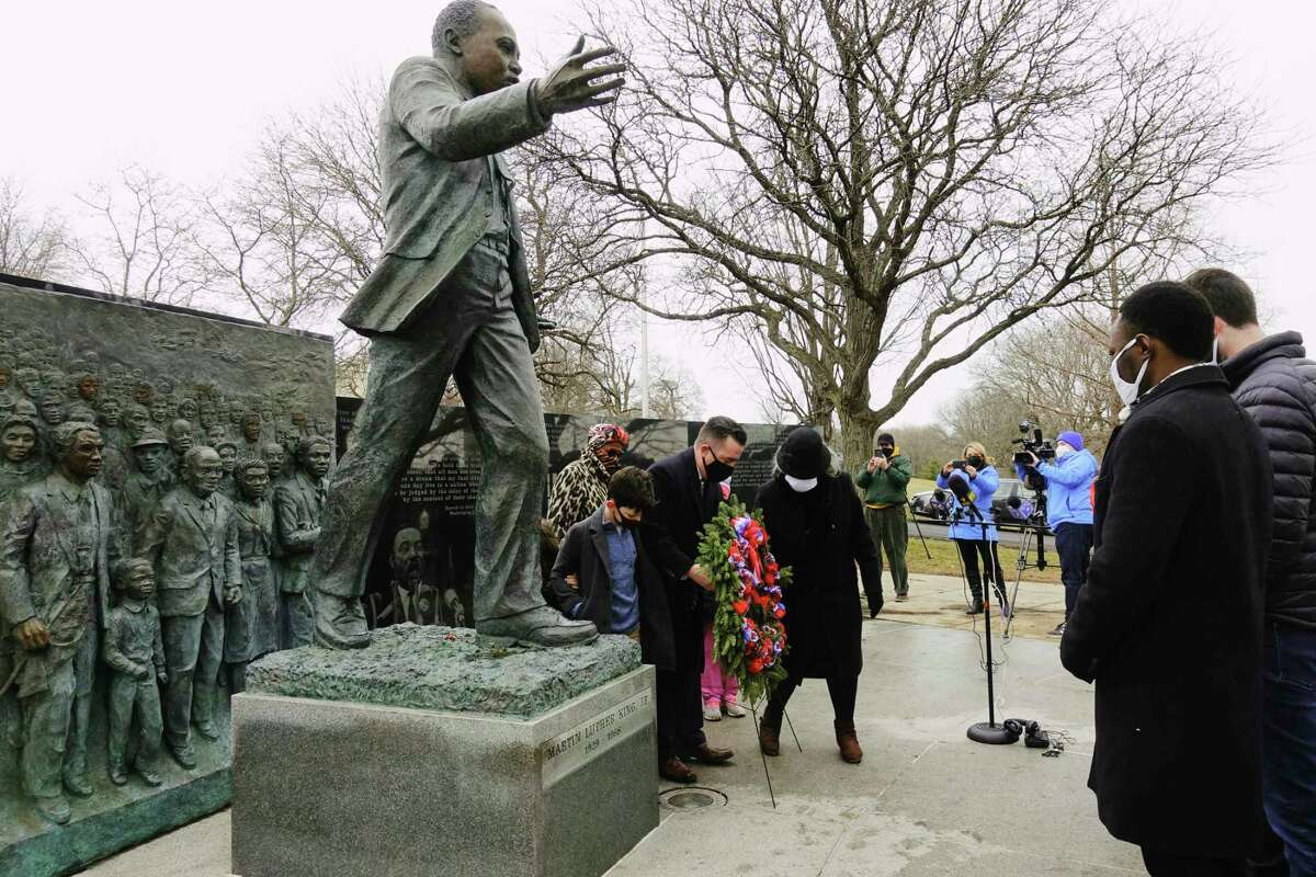 Albany County Legislature Chairman Andrew Joyce and legislator Wanda Willingham place a wreath at the Dr. Martin Luther King, Jr. monument in Lincoln Park on Monday, Jan. 18, 2021, in Albany, N.Y. (Paul Buckowski/Times Union)