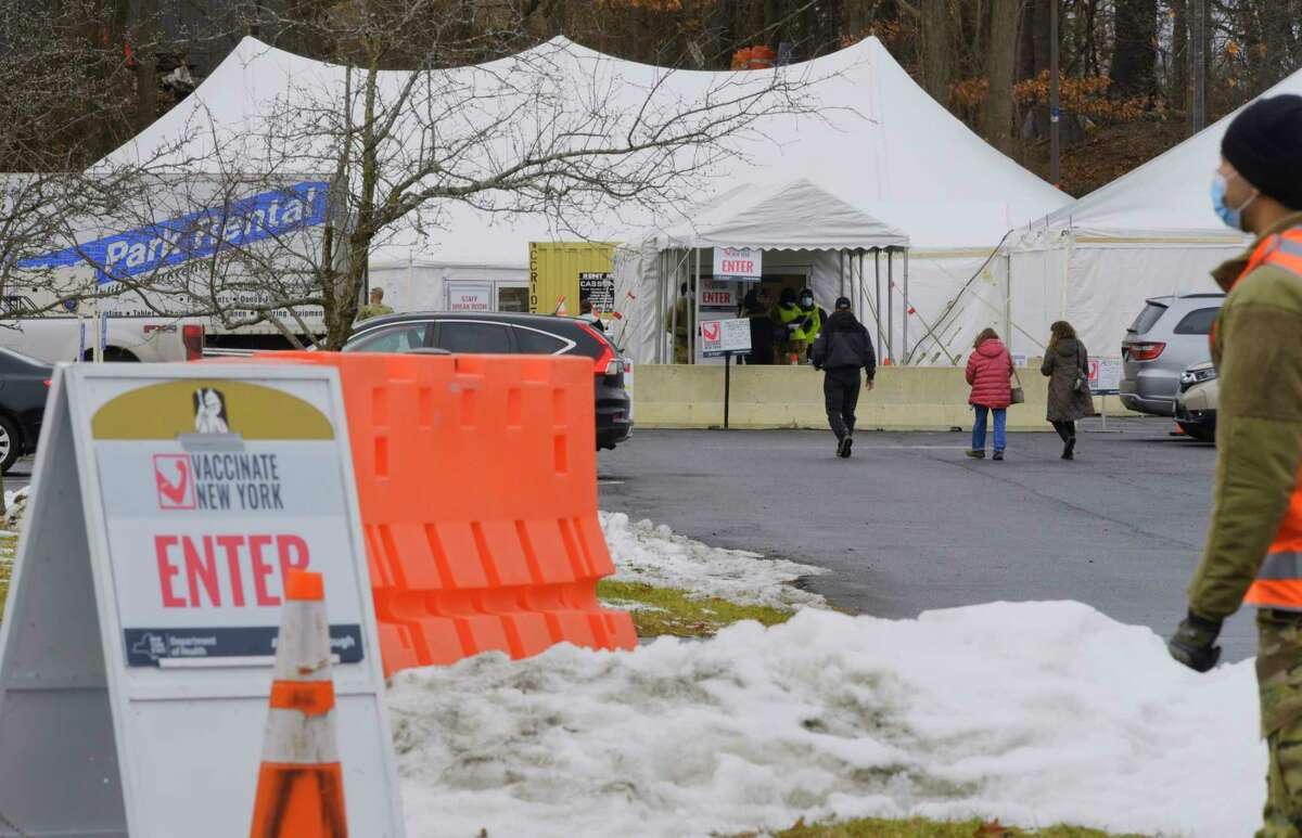 People make their way into the New York State Covid-19 vaccination site at the University at Albany on Monday, Jan. 18, 2021, in Albany, N.Y. (Paul Buckowski/Times Union)