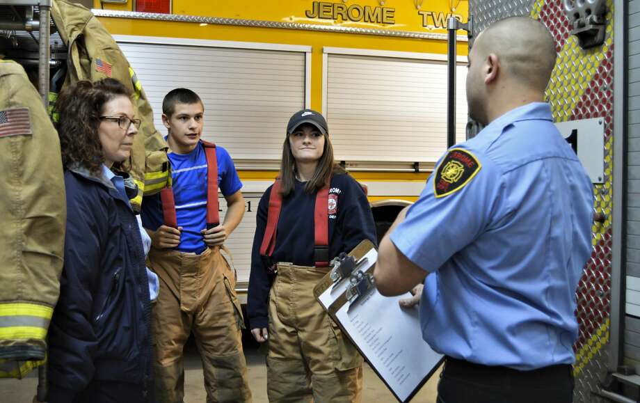 From left, Jerome Township Fire Department Cadet Program Coach Dawn Wilson, Cadet Alex Goodson and Cadet Carolina Kern listen as Cadet Program Coach Jordan Ortiz, right, gives directions for a scavenger hunt activity during which the cadets had to locate certain pieces of equipment inside Jerome Township Fire Station #1 on Friday, Jan. 15, 2021. (Ashley Schafer/ashley.schafer@hearstnp.com) Photo: (Ashley Schafer/ashley.schafer@hearstnp.com)