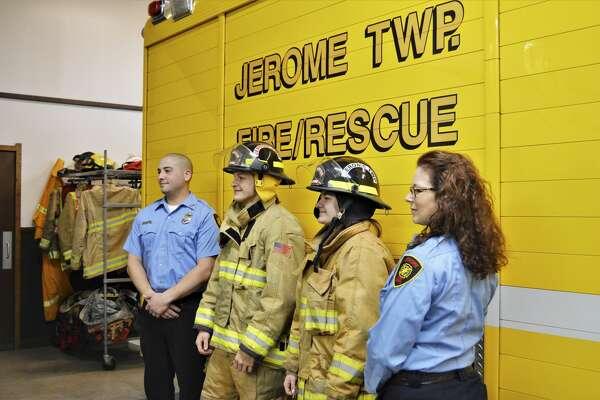 From left, Jerome Township Fire Department Cadet Program Coach Jordan Ortiz, Cadet Alex Goodson, Cadet Carolina Kern and Cadet Program Coach Dawn Wilson pose for a photo Friday, Jan. 15, 2021 at Jerome Township Fire Station #1. (Ashley Schafer/ashley.schafer@hearstnp.com)