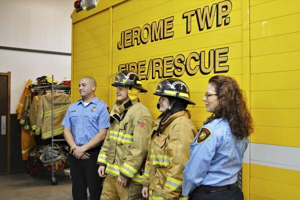 From left, Jerome Township Fire Department Cadet Program Coach Jordan Ortiz, Cadet Alex Goodson, Cadet Carolina Kern and Cadet Program Coach Dawn Wilson pose for a photo Friday, Jan. 15, 2021 at Jerome Township Fire Station #1. (Ashley Schafer/ashley.schafer@hearstnp.com)