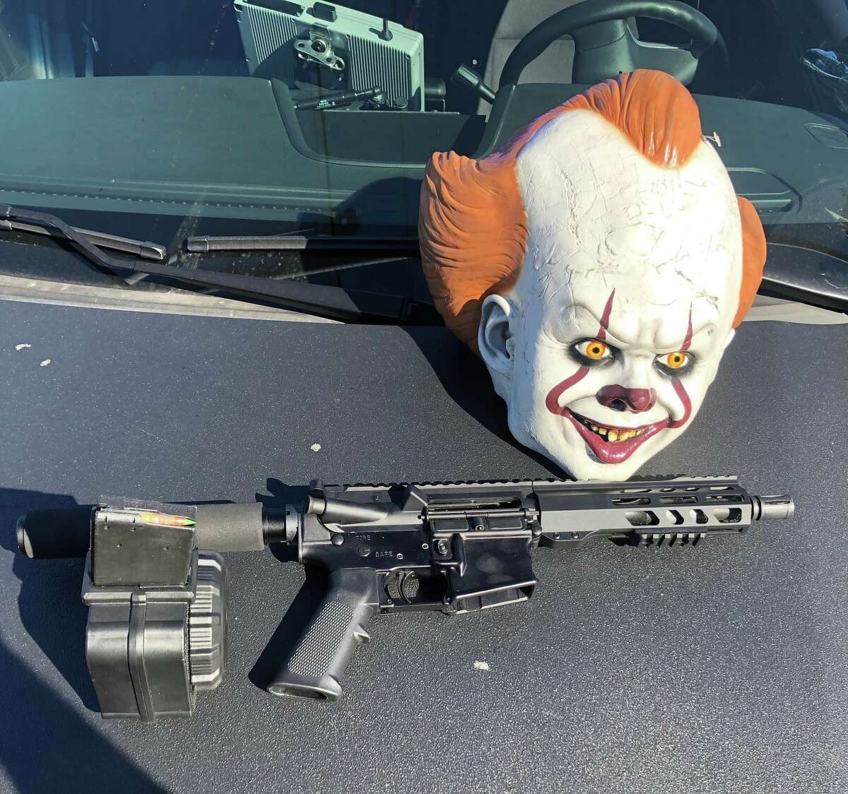 The AR-15, which had 50-round drum machine with one bullet in the chamber, was found concealed in a bag in the vehicle's backseat, San Leandro police said.