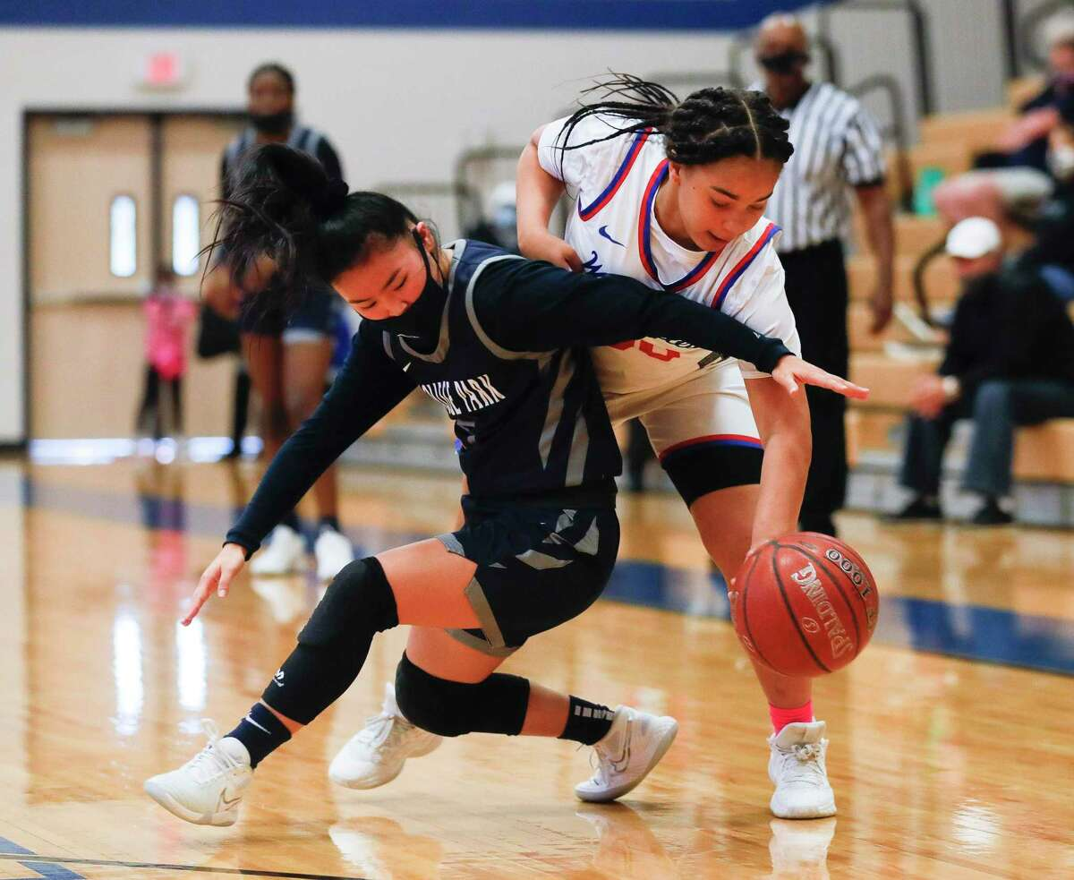 Oak Ridge shooting guard Taylor Jones (30) knocks the ball away from College Park guard Mia Olguin (5) during the third quarter of a District 13-6A high school basketball game at Oak Ridge High School, Saturday, Jan. 2, 2020.