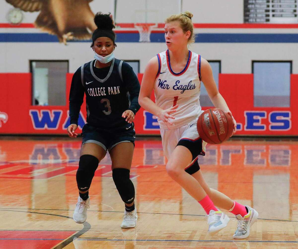 Oak Ridge guard Nicole Petrakovitz (1) drives past College Park guard Treasure Harrison (3) during the second quarter of a District 13-6A high school basketball game at Oak Ridge High School, Saturday, Jan. 2, 2020.