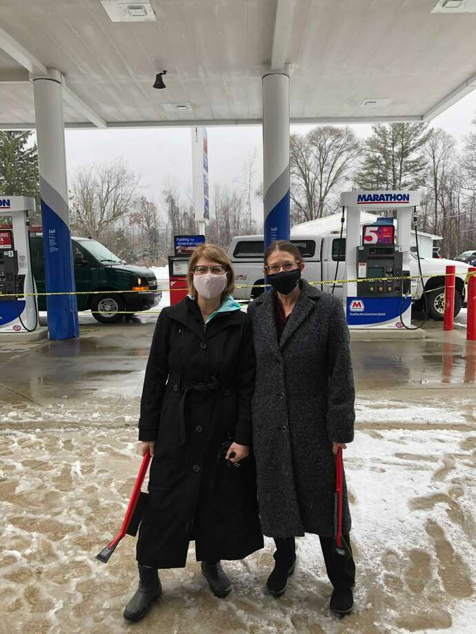 Lisa Robinson of Robinson Industries and Dolores Porte pose outside of Ellis Party Store in Sanford. Robinson Industries recently made a donation to the Sanford shop in response to the flood last May. Photo: Photo Provided/Dolores Porte