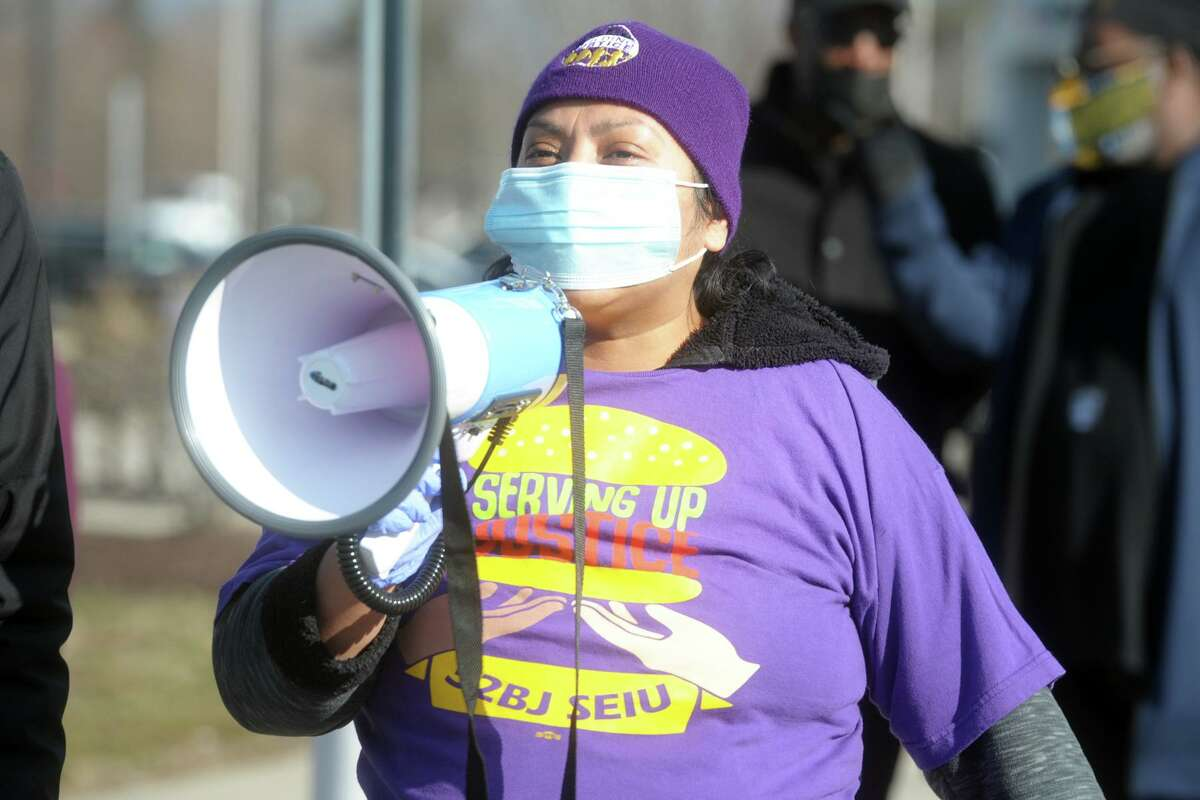 Azucena Santiago, who works at one of the Milford Service Plaza McDonald's, speaks at a rally at the northbound Fairfield Service Plaza, in Fairfield, Conn. Jan. 18, 2021. About a hundred service plaza workers gathered in honor of Martin Luther King Jr. Day and to speak about their rights.