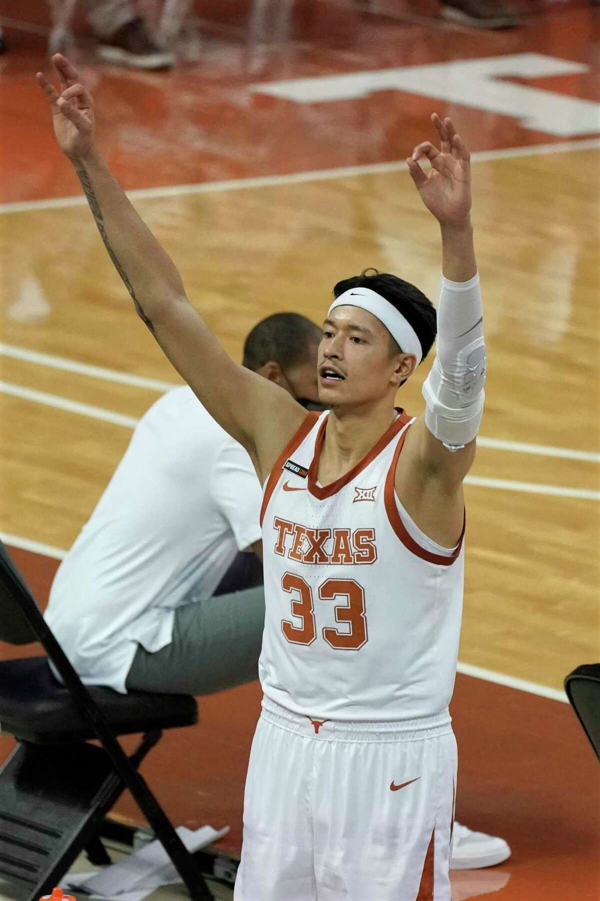 Texas' Kamaka Hepa (33) reacts after a teammate's three-point basket against Kansas State during the second half of an NCAA college basketball game in Austin, Texas, Saturday, Jan. 16, 2021. (AP Photo/Chuck Burton)