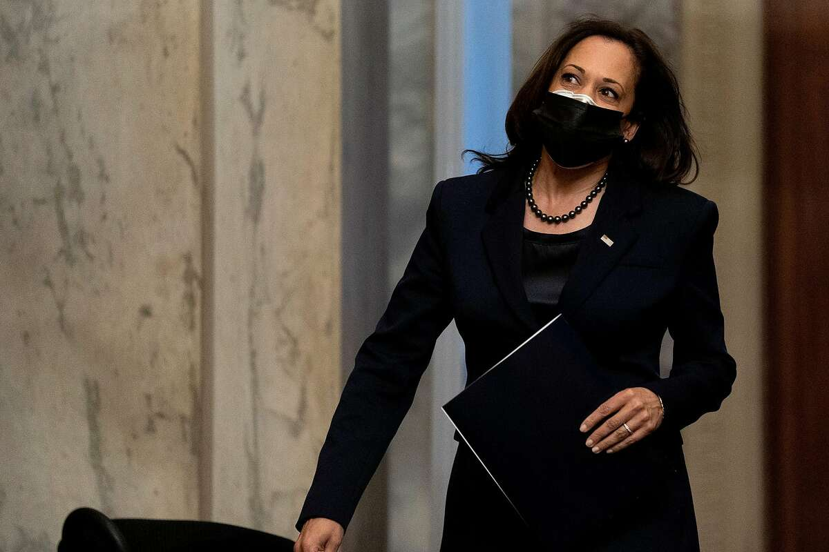 U.S. Vice President-elect Kamala Harris wears a protective mask while arriving to the U.S. Capitol on Dec. 11, 2020, in Washington, D.C. (Stefani Reynolds/Getty Images/TNS)
