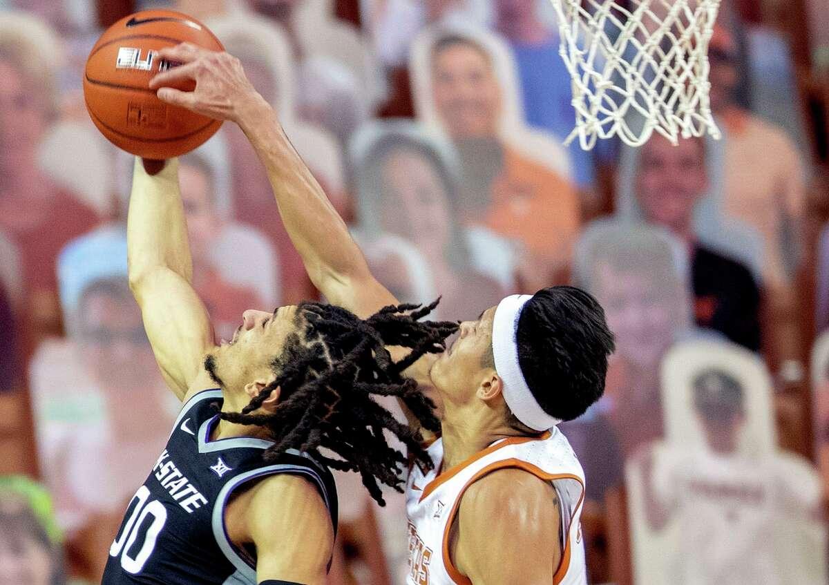 Texas forward Kamaka Hepa blocks a shot against Kansas State guard Mike McGuirl.