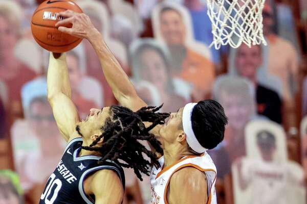 Texas forward Kamaka Hepa blocks a shot against Kansas State guard Mike McGuirl.