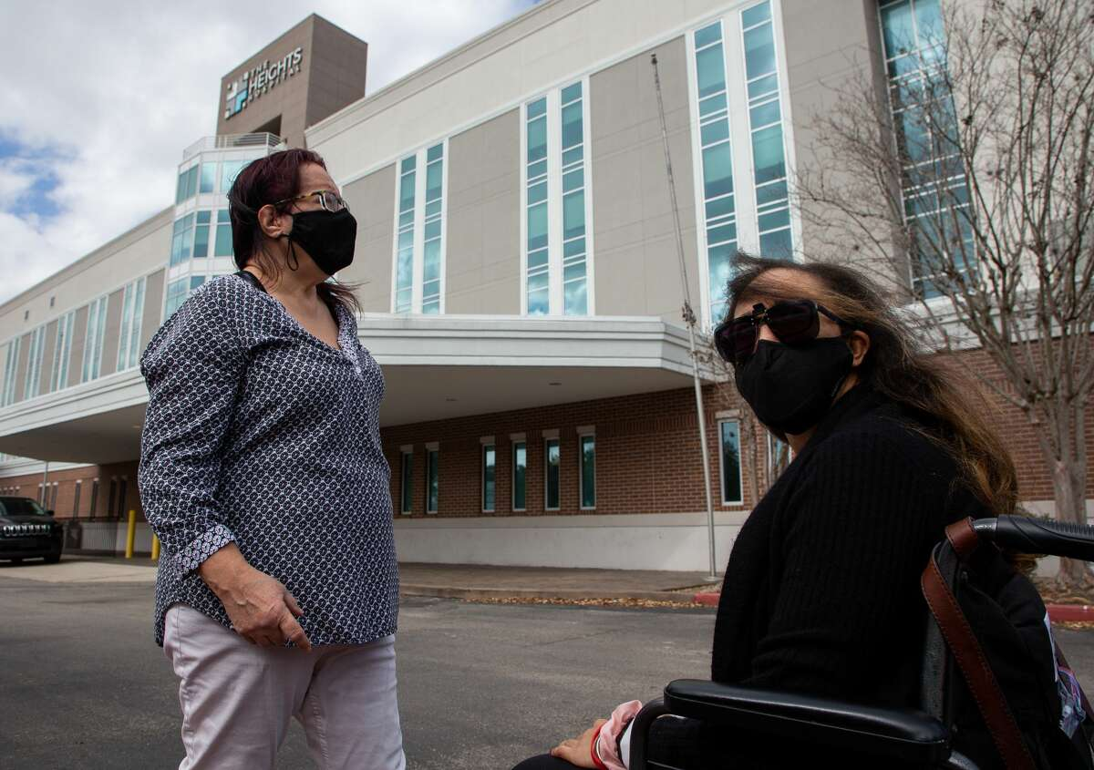 Liza Fisher, right, and her mother Ann Fisher showed up for an appointment at the Heights Hospital only to find out the doors were locked Monday, Jan. 18, 2021, in Houston. The hospital filed for bankruptcy, leaving staff and patients locked out without any notice.