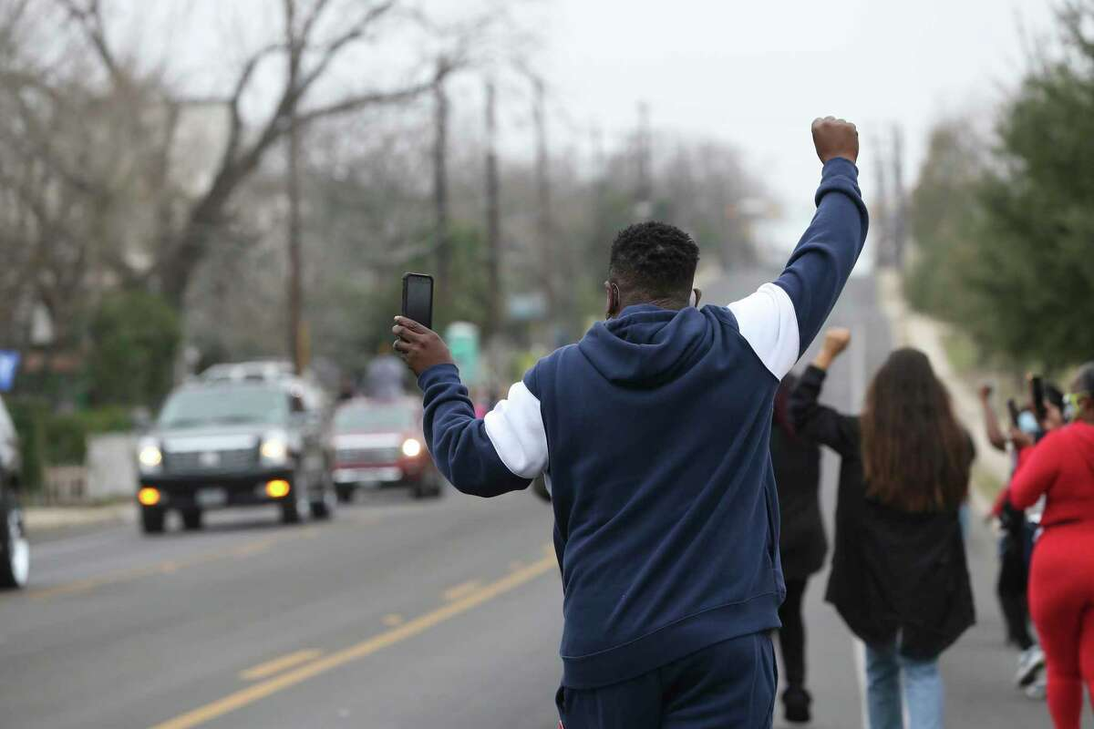 A small group of marchers participate in the People's March for Freedom from Pittman-Sullivan Park to Martin Luther King, Jr. Park, Monday, Jan. 18, 2021. The annual MLK march went virtual this year due to coronavirus concerns.