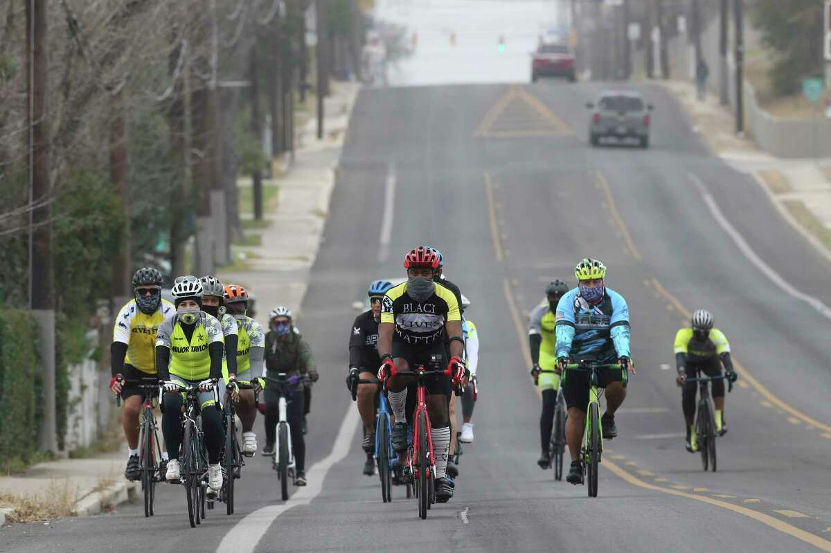 A group of cyclists participate in the small People's March for Freedom, Monday, Jan. 18, 2021. A small group participated in the march. The annual MLK march went virtual due to coronavirus concerns and traditionally draws thousands of participants.