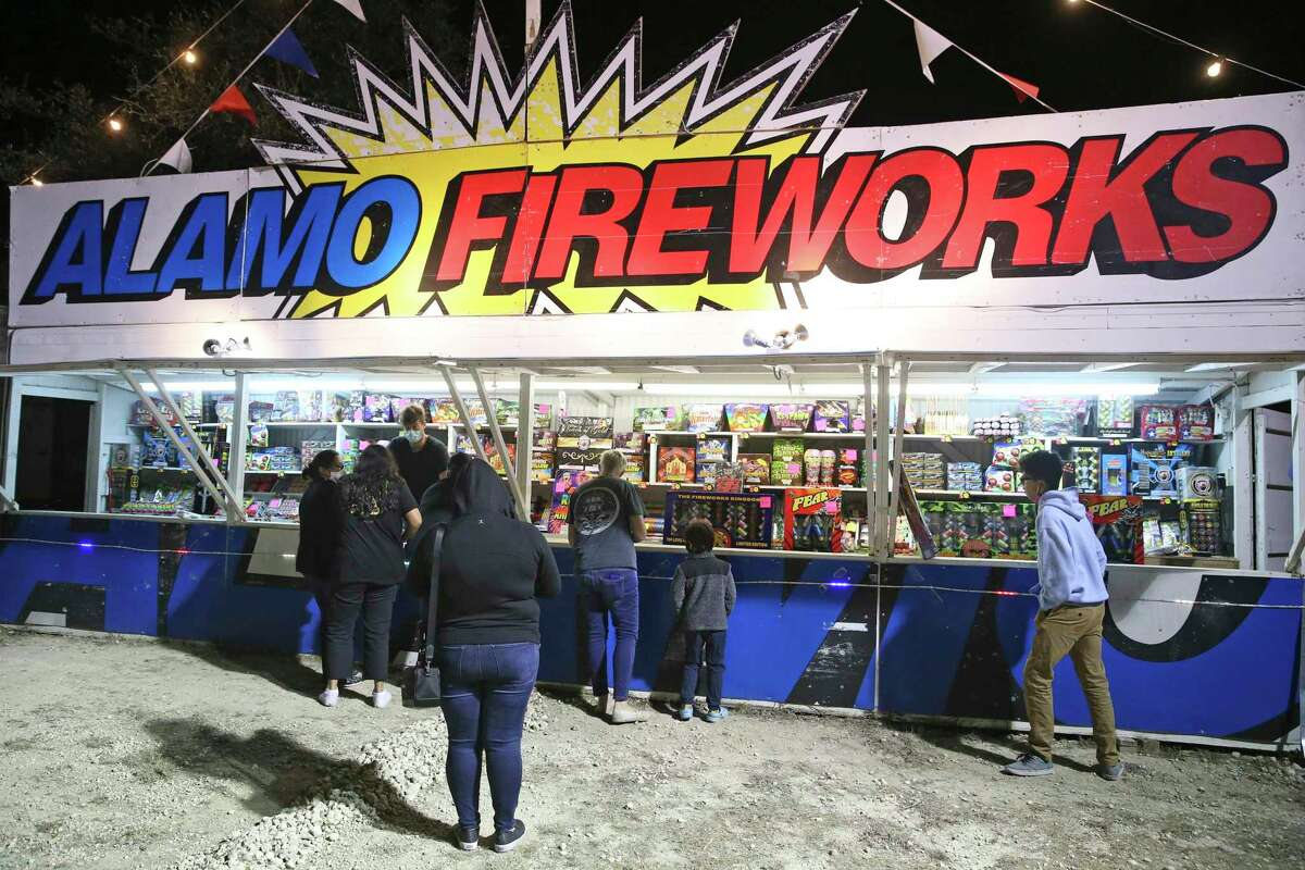 Nehemiah Nulton sells fireworks to groups of people arriving at his Alamo Fireworks stand on East Borgfeld Road on Dec. 28. A citywide celebration on New Year's Eve led to only one citation and 21 warning for fireworks use.