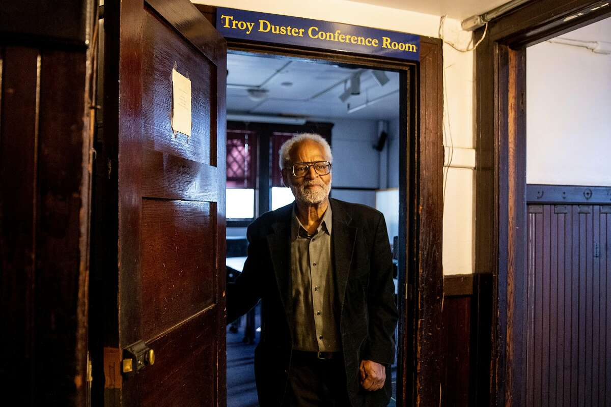Troy Duster stands under the doorway of the conference room named after him at the Institute for the Study of Societal Issues.