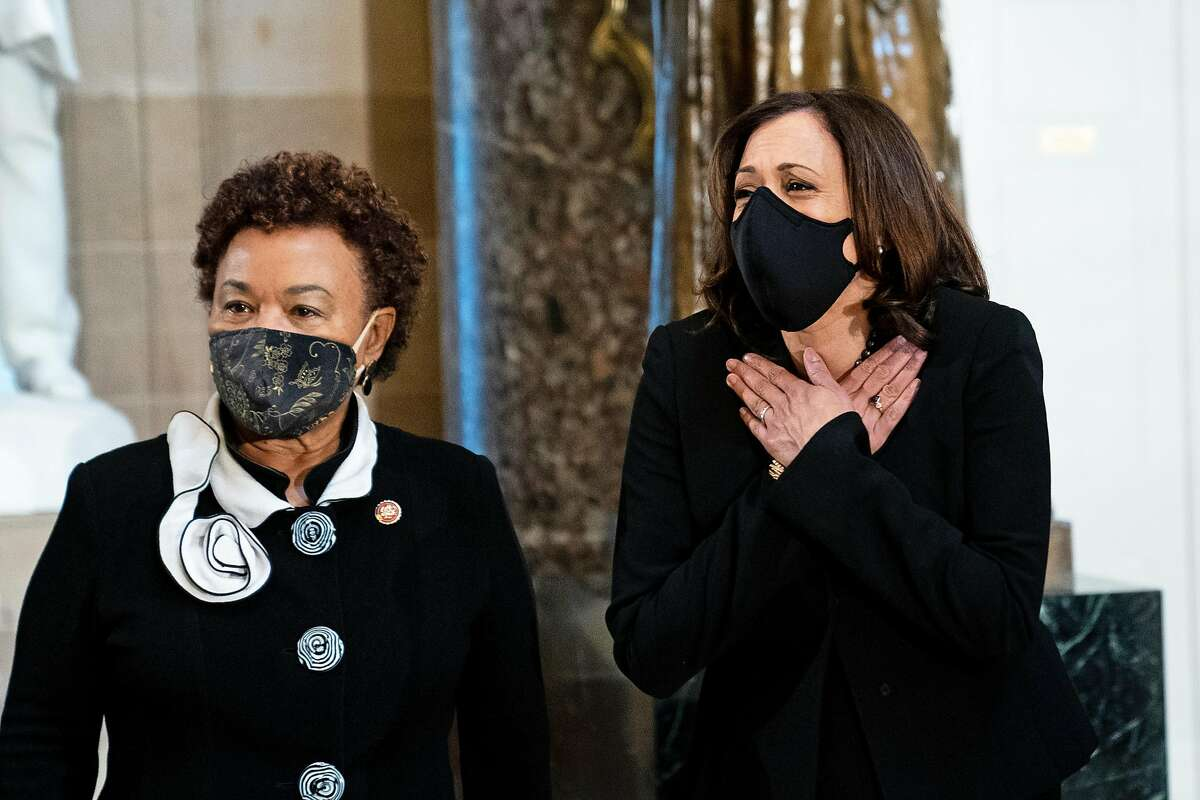 Sen. Kamala Harris (right), with Rep. Barbara Lee, will be sworn in as vice president on Wednesday.