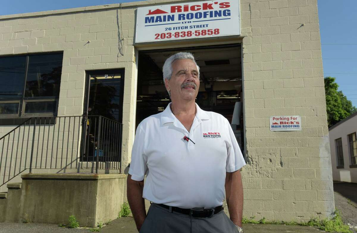Rick Tavella at Rick's Main Roofing on July 9, 2020, in Norwalk. Rick's Main Roofing was one of many Norwalk businesses to receive a PPP loan from the Small Business Administration. The Paycheck Protection Program is a loan designed to provide a direct incentive for small businesses to keep their workers on the payroll.