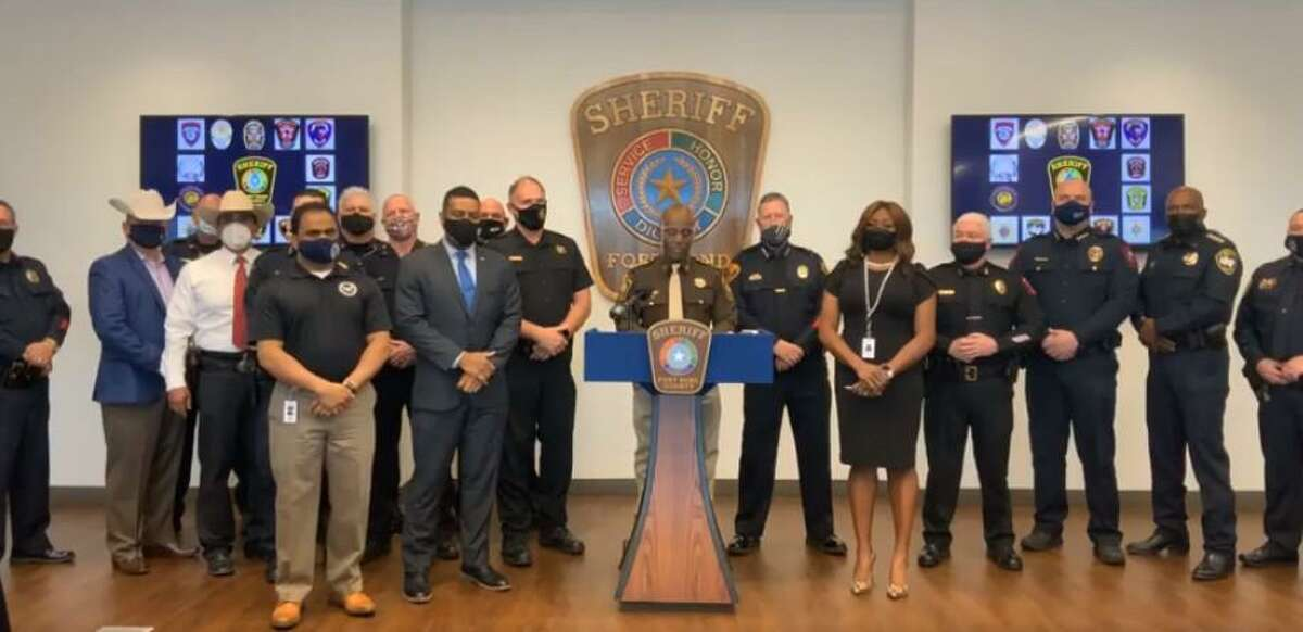Fort Bend County Sheriff Eric Fagan discusses preparations for potential violence on Inauguration Day flanked by representatives from the Texas Rangers, Fort Bend County Constable's Office Precincts 1, 2 and 4 and Arcola, Fulshear, Katy, Missouri City, Needville, Richmond, Rosenberg, Stafford and Sugar Land police departments on Jan. 18, 2021.