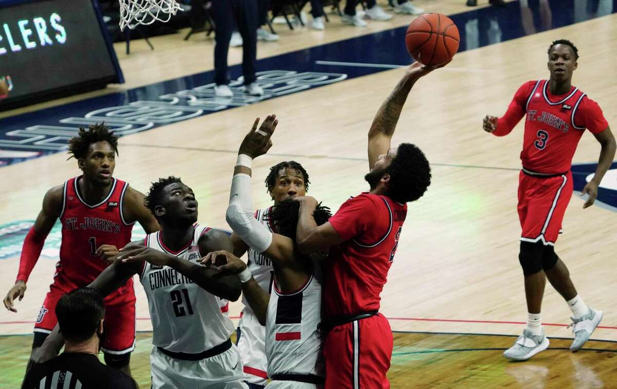 St. John's guard Julian Champagnie (2) shoots against Connecticut in the second half of an NCAA college basketball game Monday, Jan. 18, 2021, in Storrs, Conn. (David Butler II/Pool photo via AP)