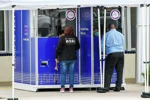Laredoans wait their turn at the COVID-19 Test Kiosk, Friday Nov. 13, 2020, at the Sophie Christen McKendrick, Francisco Ochoa, Fernando Salinas Branch Library.