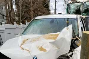 A car crashed into a utility pole on Maple Avenue in Westport, Conn. on Jan. 18, 2021.