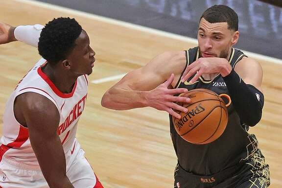 Victor Oladipo #7 of the Houston Rockets knocks the ball away from Zach LaVine #8 of the Chicago Bulls at the United Center on January 18, 2021 in Chicago, Illinois. (Photo by Jonathan Daniel/Getty Images)