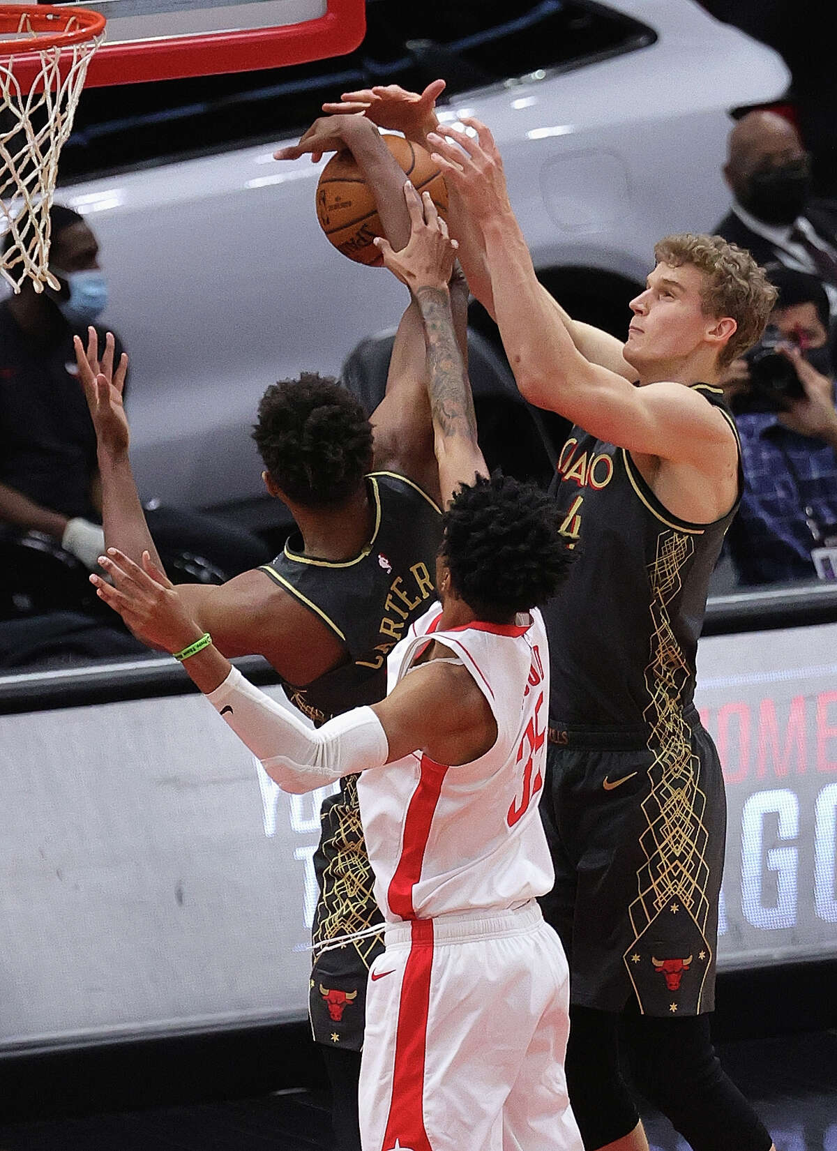 CHICAGO, ILLINOIS - JANUARY 18: Lauri Markkanen #24 (R) and Wendell Carter Jr. #34 of the Chicago Bulls battle for a rebound with Christian Wood #35 of the Houston Rockets at the United Center on January 18, 2021 in Chicago, Illinois. NOTE TO USER: User expressly acknowledges and agrees that, by downloading and or using this photograph, User is consenting to the terms and conditions of the Getty Images License Agreement. (Photo by Jonathan Daniel/Getty Images)