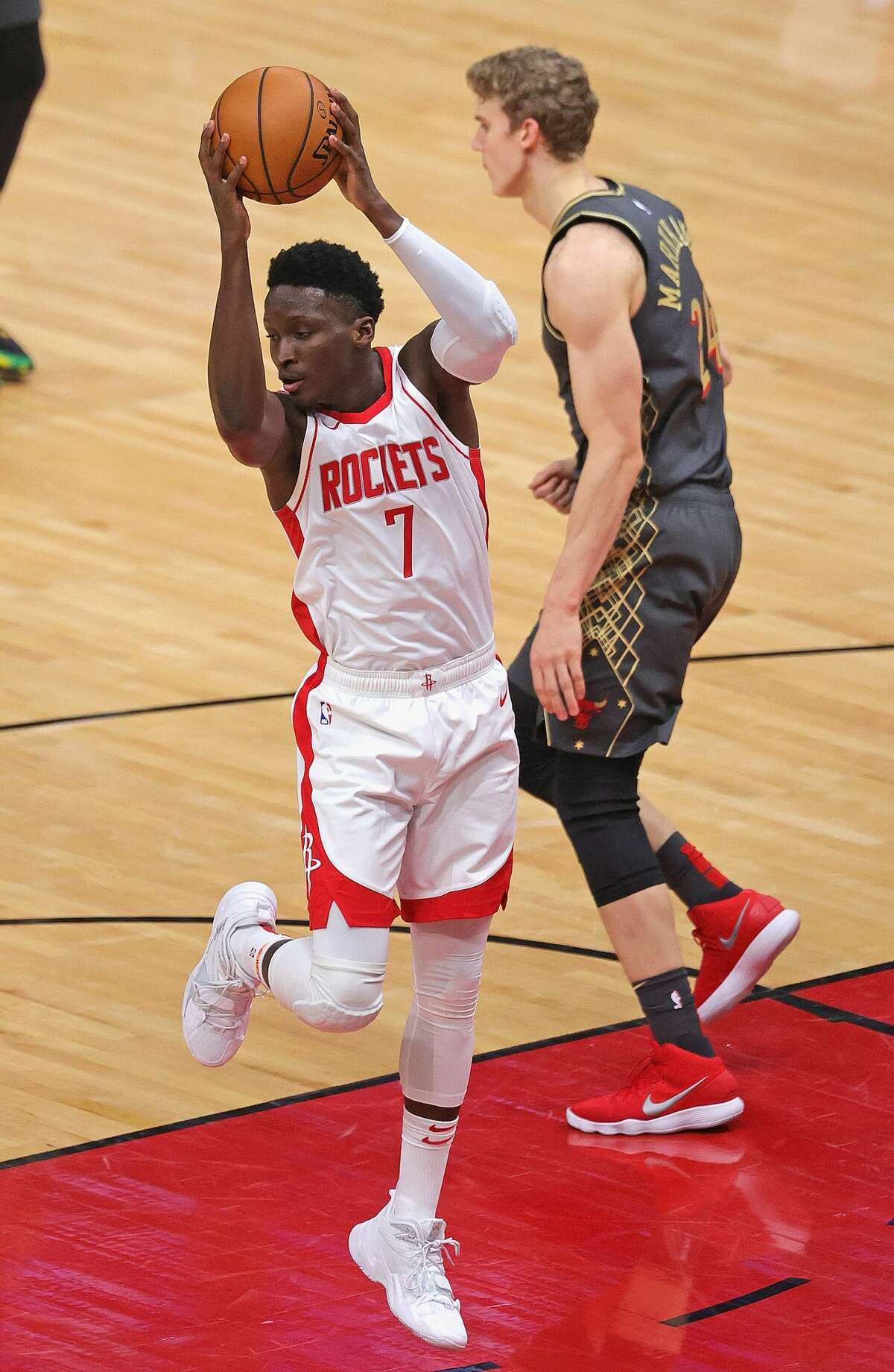 CHICAGO, ILLINOIS - JANUARY 18: Victor Oladipo #7 of the Houston Rockets rebounds against the Chicago Bulls at the United Center on January 18, 2021 in Chicago, Illinois. NOTE TO USER: User expressly acknowledges and agrees that, by downloading and or using this photograph, User is consenting to the terms and conditions of the Getty Images License Agreement. (Photo by Jonathan Daniel/Getty Images)