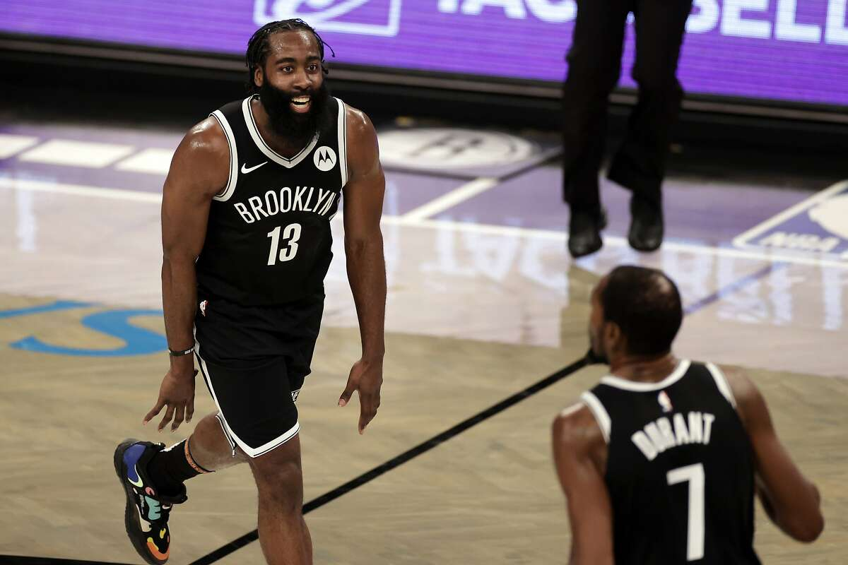 Brooklyn's James Harden (13) scored 34 while teammate Kevin Durant added 30 in the Nets' victory over Milwaukee.