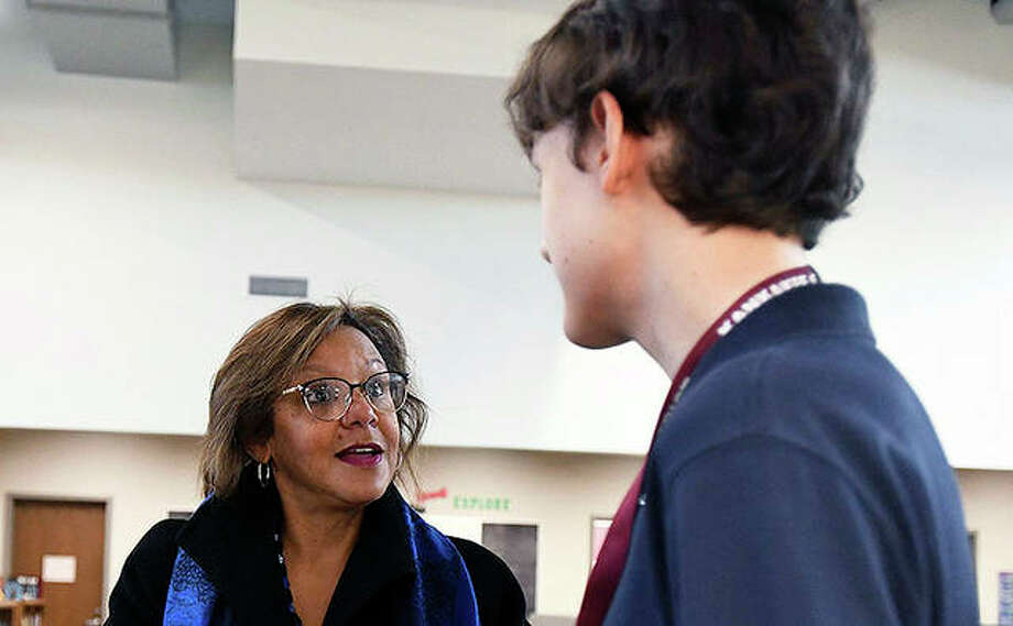 Kankakee High School freshman David Love talks to U.S. Rep. Robin Kelly after a visit to recognize his project that won the 2019 Congressional App Challenge for Illinois' Second Congressional District. Photo: Tiffany Blanchette | Daily Journal (AP)