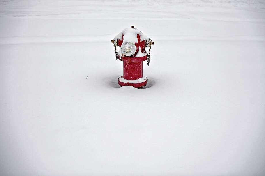 """The City of Midland asks residents to help their fire and water departments work by """"adopting"""" the fire hydrant closest to their home or business to keep it free of snow during the winter season. (Daily New file photo)"""