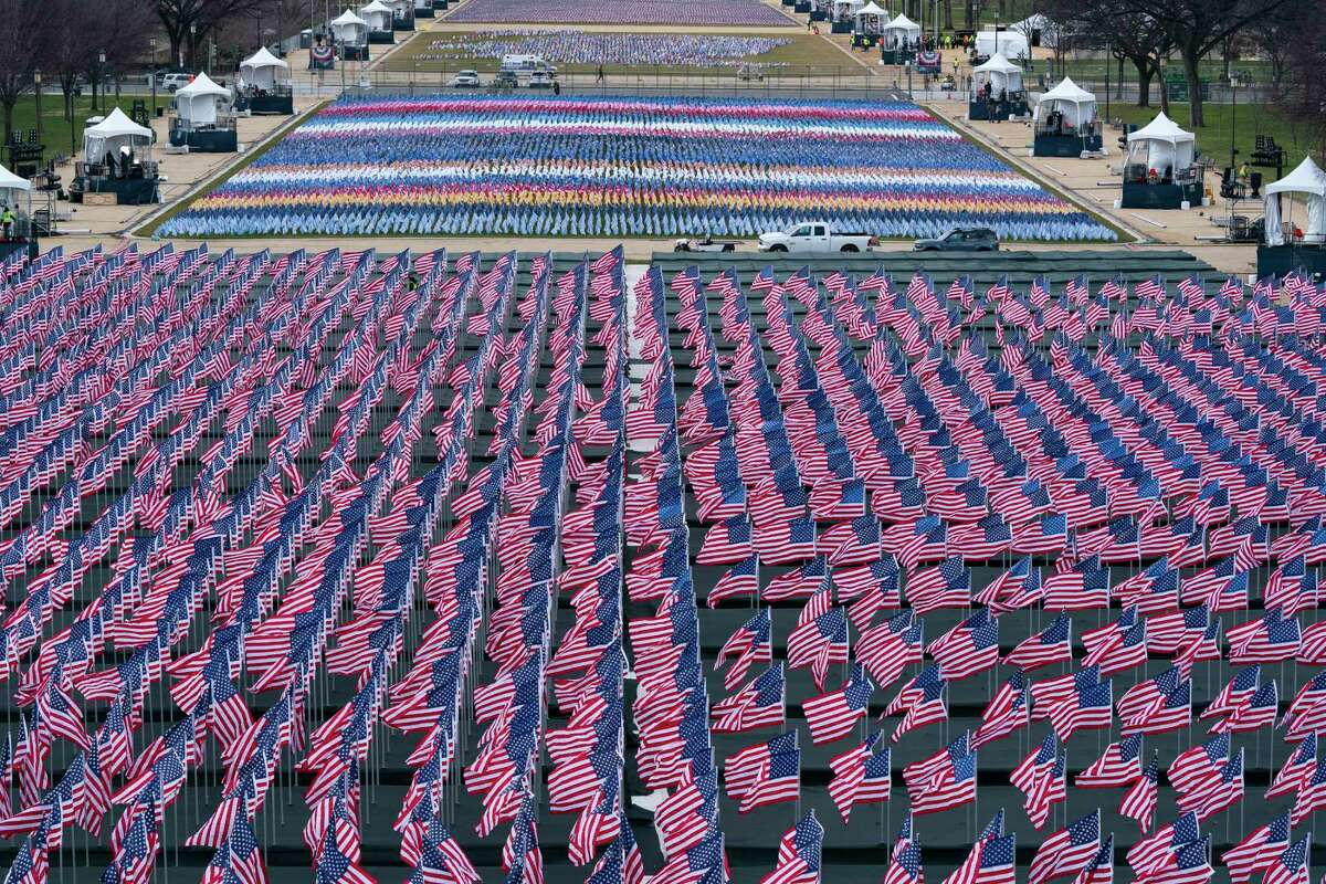 Flags are placed on the National Mall ahead of the inauguration of President-elect Joe Biden and Vice President-elect Kamala Harris, Monday, Jan. 18, 2021, in Washington.