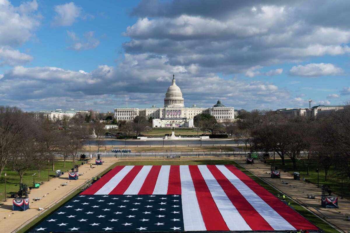A large American Flag is are placed on the National Mall, with the U.S. Capitol behind, ahead of the inauguration of President-elect Joe Biden and Vice President-elect Kamala Harris, Monday, Jan. 18, 2021, in Washington.