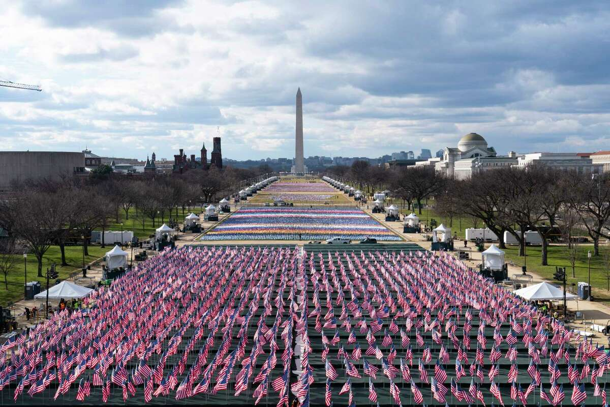 Flags are placed on the National Mall, looking towards the Washington Monument, and the Lincoln Memorial, ahead of the inauguration of President-elect Joe Biden and Vice President-elect Kamala Harris, Monday, Jan. 18, 2021, in Washington.