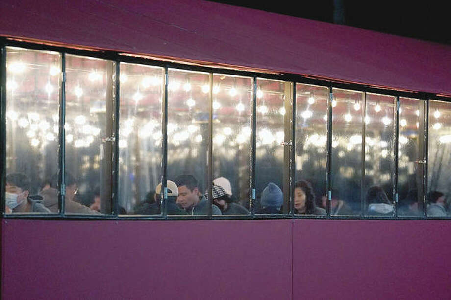People sit in a heated tent Saturday outside a restaurant in Glenview. Gov. J.B. Pritzker and state health officials said Monday that two regions — including Morgan and surrounding counties — will be allowed to reopen bars and indoor restaurant dining after moving to the fourth of five COVID-19 mitigation phases. Photo: Nam Y. Huh | AP