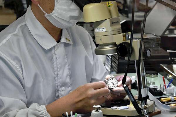 A watchmaker in the Grand Seiko Studio Shizukuishi handles tiny precision parts.