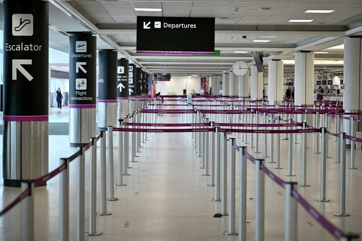 The Edinburgh, Scotland, airport is nearly empty Monday as travel corridors close until February 15. The IEA predicts that demand for petroleum will decline as a result of new lockdowns.