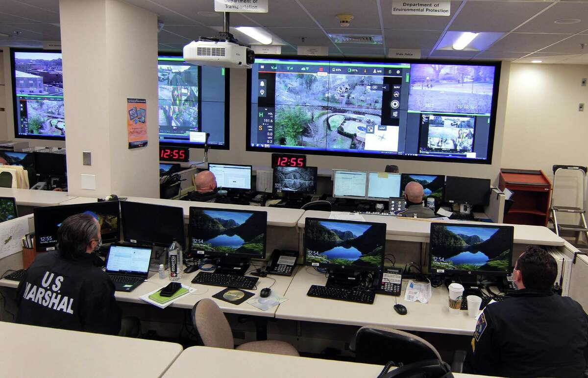 Law enforcement officials monitor activity from the state's emergency operations center in Hartford, Conn., on Sunday, Jan. 17, 2021. A few hundred law enforcement personnel were stationed at the Capitol building on Sunday for a planned protest of pro-Trump supporters.
