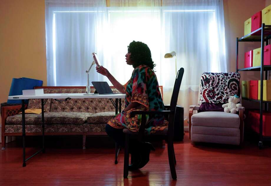 Saundra Rogers talks to her son, Nelson Orellana Garcia, via video call in December. Photo: Washington /The Washington Post) / The Washington Post