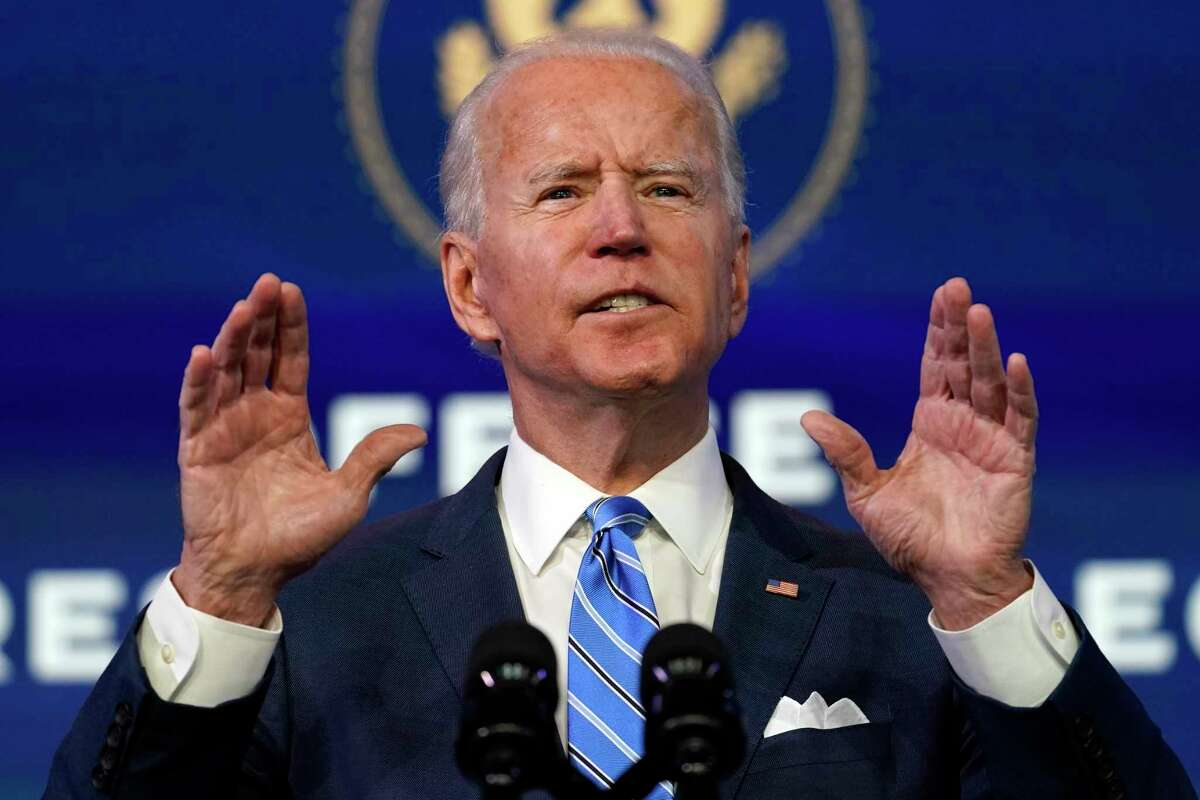 In this Jan. 14, 2021 photo, President-elect Joe Biden speaks during an event at The Queen theater, in Wilmington, Del.