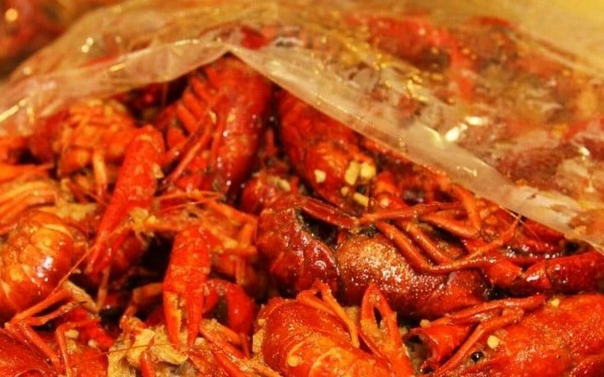 LA Crawfish serves crawfish with garlic butter, house Cajun rub or hot and sour flavor -- presented in clear plastic bags full of spicy seasoning.