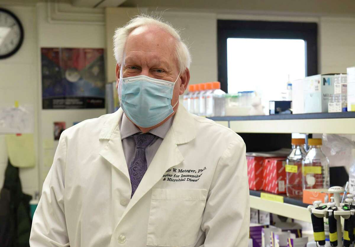 Dennis Metzger, chairman of Albany Medical Center Department of Immunology and Microbial Disease, stands in his laboratory at Albany Medical Center on Friday, Jan. 15, 2021 in Albany, N.Y. (Lori Van Buren/Times Union)