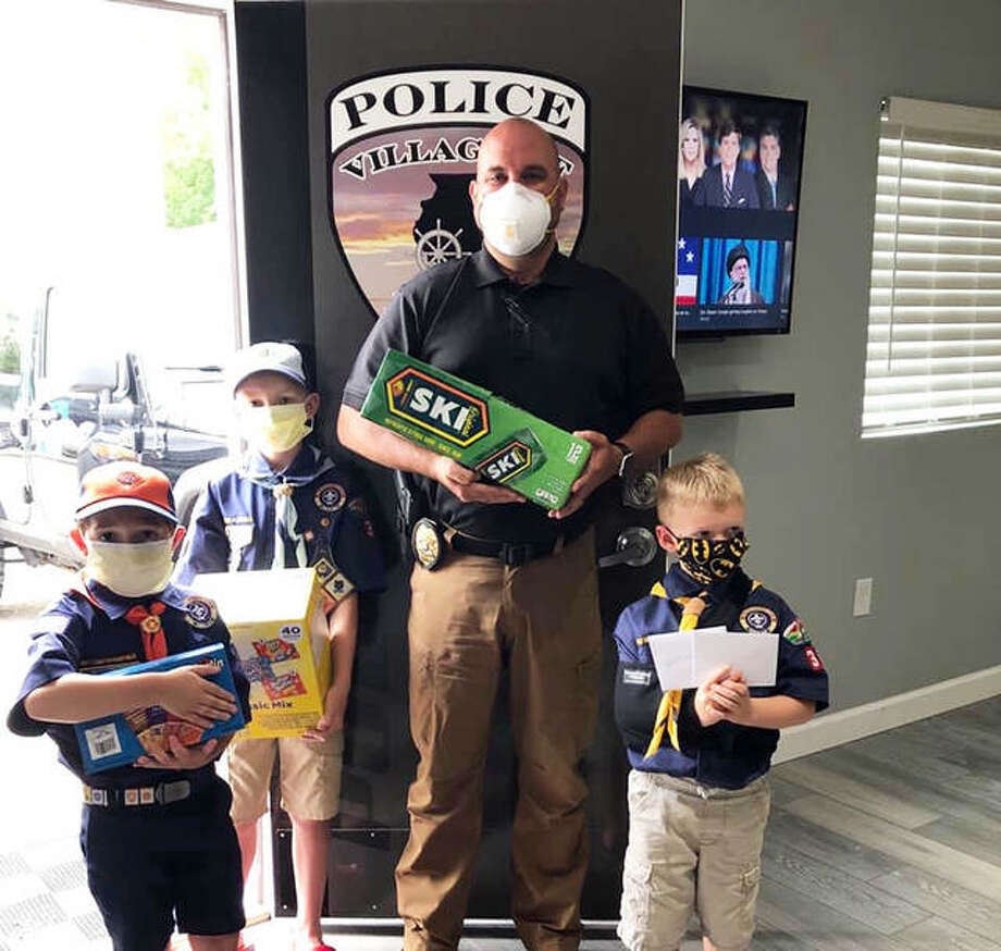Titus, Nolyn and Grayson Moore of Cub Scout Pack 8038 from the Troy Lions Club visit the Troy Police Department. Photo: For The Intelligencer