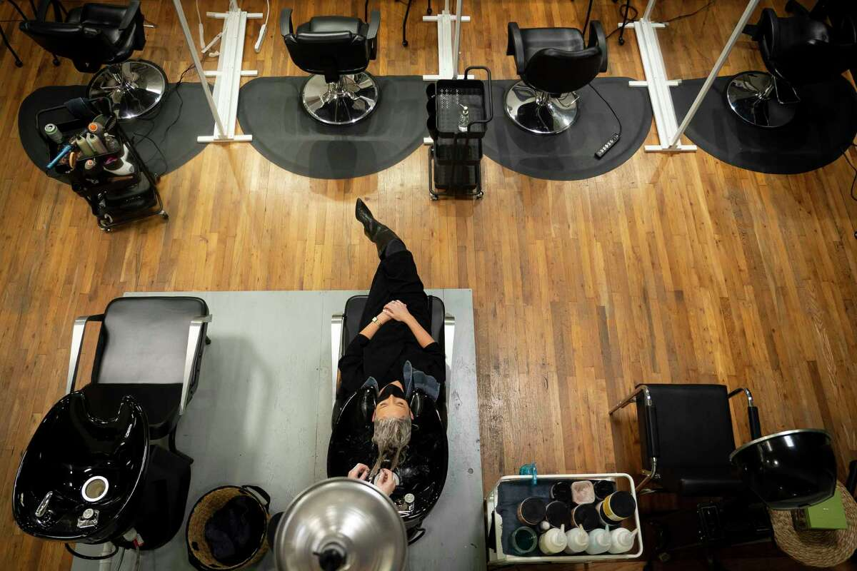 Emily Ribas washes Taylor Ferrara's hair before cutting and styling it, Friday, Jan. 15, 2021, at Reserved Salon in Houston.