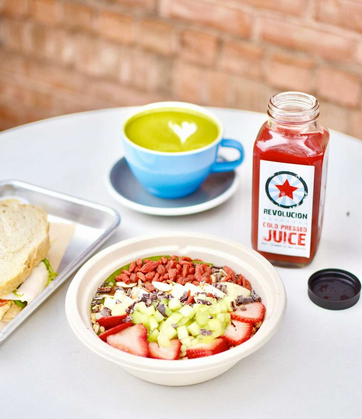 Revolucion has coffee drinks, cold-pressed juices, tacos, salads, acai bowls and other dishes made with health-focused ingredients.
